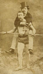 Blondin carrying his manager, Harry Colcord, on a tightrope.